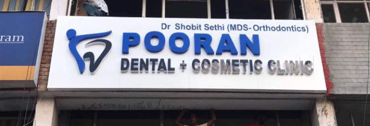 Official Logo of Pooran Dental & Cosmetic Clinic